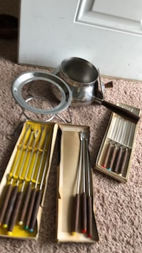 Fondue appliances: stainless steel pot, cover and stand and 13 forks 166 mi