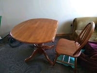 round brown wooden pedestal table with four chairs Spokane, 99208