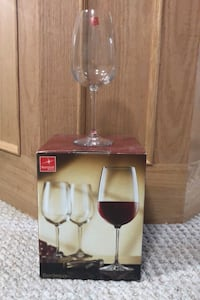 4 wine glasses  In box never used