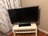 Black flat screen tv with white wooden tv stand Paterson, 07522