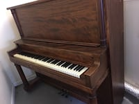 Brown wooden upright piano Acworth, 30101