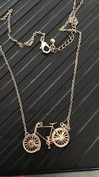 Gold-colored chain-link necklace with bicycle pendant New York, 11426