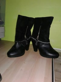 pair of black leather chunky heeled booties Langley