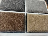 four assorted-color rugs