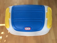 Blue, white, and yellow Little Tikes toy box