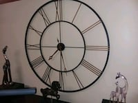 round black and brown analog wall clock 73 mi