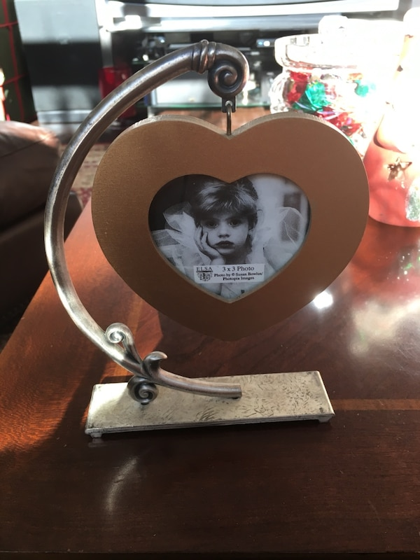 Used heart-shaped silver and brown hanging photo frame for sale in ...