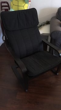 black wooden framed gray padded armchair 785 km