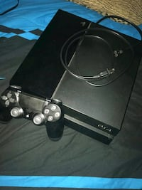 black Sony PS4 console with controller Kannapolis, 28081
