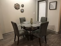 5-piece dining set, glass table and faux suede chairs Atlanta