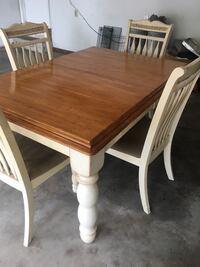 Table with 4 chairs. Measurements without leaf (5ft  and .25 inches long). The measurement with the leaf is ( 41.5 width 78 inches long) Jacksonville