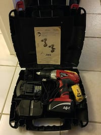 red and black Skil cordless hand drill in case
