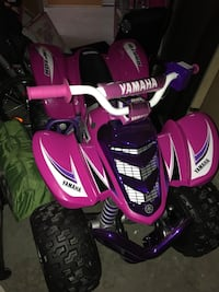 white, purple, and pink Yamaha ATV Seattle, 98121