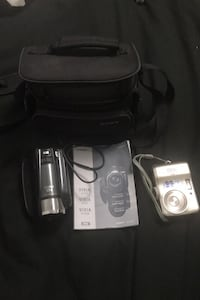 Canon video camera and Nikon digital camera