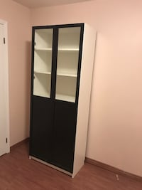 Moving Sale: A classy Ikea bookshelf with two glass doors Markham, L3P 6Y8
