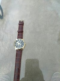 gold and black chronograph watch with brown strap Gaithersburg, 20886