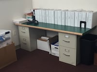 Filing cabinets and green counter tops