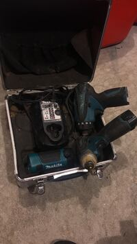 black and gray Makita cordless power drill
