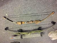 brown and black compound bow 186 mi