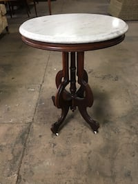 Oval marble top Victorian table Commerce, 90040