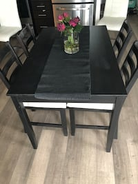 rectangular black wooden table with four chairs dining set Markham, L3T 1B4