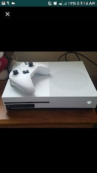 white Xbox One console with controller