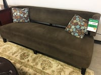 Brown suede lounge sofa with throw pillows