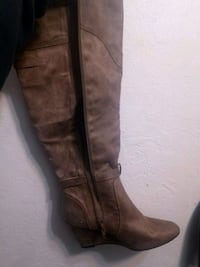 pair of brown leather knee-high boots 2345 mi