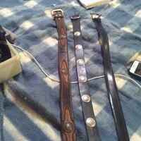 Two black and one brown leather belts