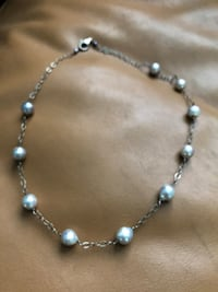 Grey pearl with silver set Phoenix, 85015