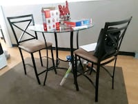 Glass top Pub style table 2 chairs