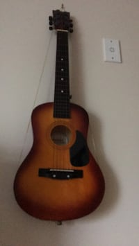 brown and black acoustic guitar Arlington, 22201