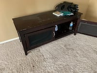 black wooden TV stand with flat screen television Coppell, 75019