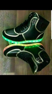 pair of black leather lighted high-top sneakers