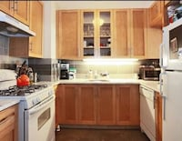 white and brown wooden kitchen cabinet New York, 11234
