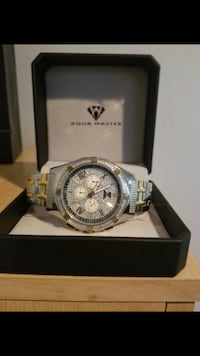 round silver chronograph watch with silver link bracelet New York, 11374