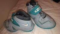 Pair of gray-and-teal nike basketball shoes College Station, 77840