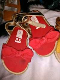 pair of red-and-white sandals Baltimore, 21214