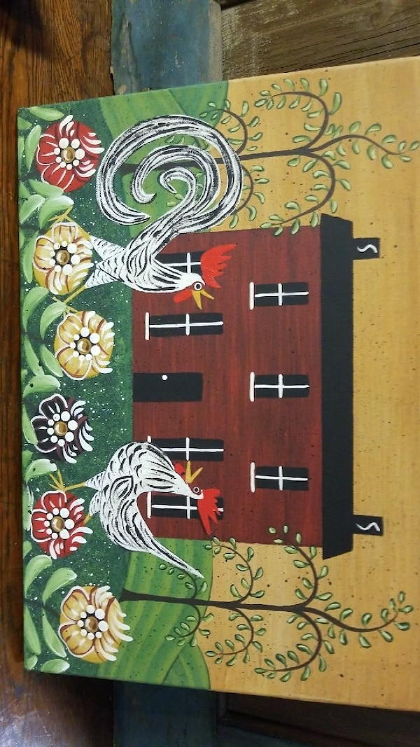 Local artist hand painted house with roosters