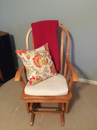 Brown wood-framed white padded glider chair