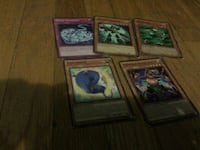five Yugi Oh trading cards