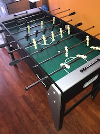 black and green foosball table