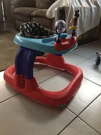 baby's blue and red Fisher-Price walker