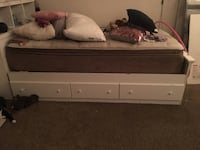 brown wooden bed frame with white mattress 2231 mi