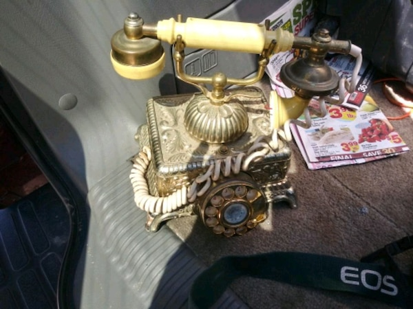 brass and black rotary telephone
