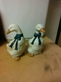 two white-and-black ceramic figurines Des Moines, 50321