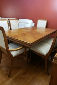 rectangular brown wooden table with four chairs di Edmonton, T6T 0B3