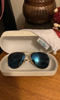 Authentic OAKLEY Caveats with gold frame, ice blue lenses Bolton, L7E 1S4