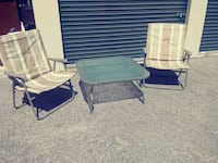 two grey metal framed folding chairs