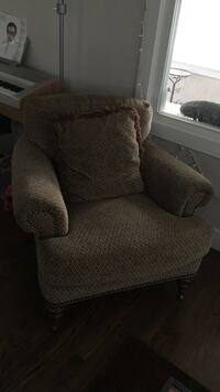 Gray fabric sofa chair with throw pillow in great condition Omaha, 68132